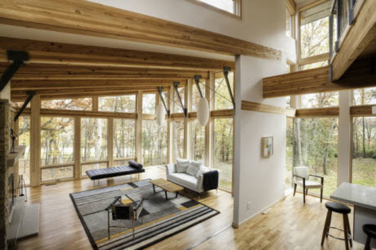 Wood beams in a room filled with glass windows