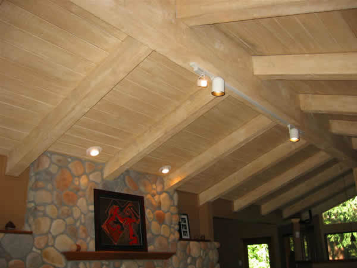 """Vaulted Ceiling"" This vaulted and beamed wood ceiling had been painted a glossy white and the customer wanted to bring it back to a natural light wood color. We achieved this by applying a glazing technique, which gives the illusion of natural wood,"