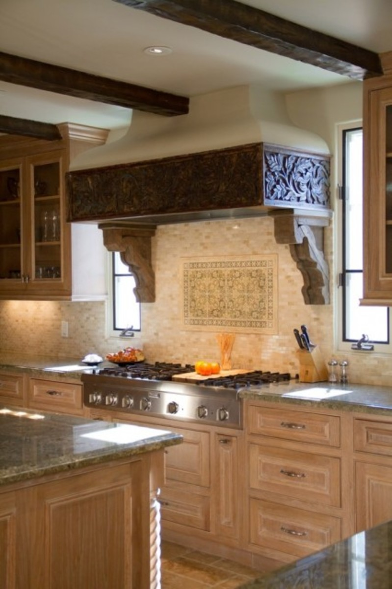 Beautiful carved wood kitchen hood with wood ceiling beams
