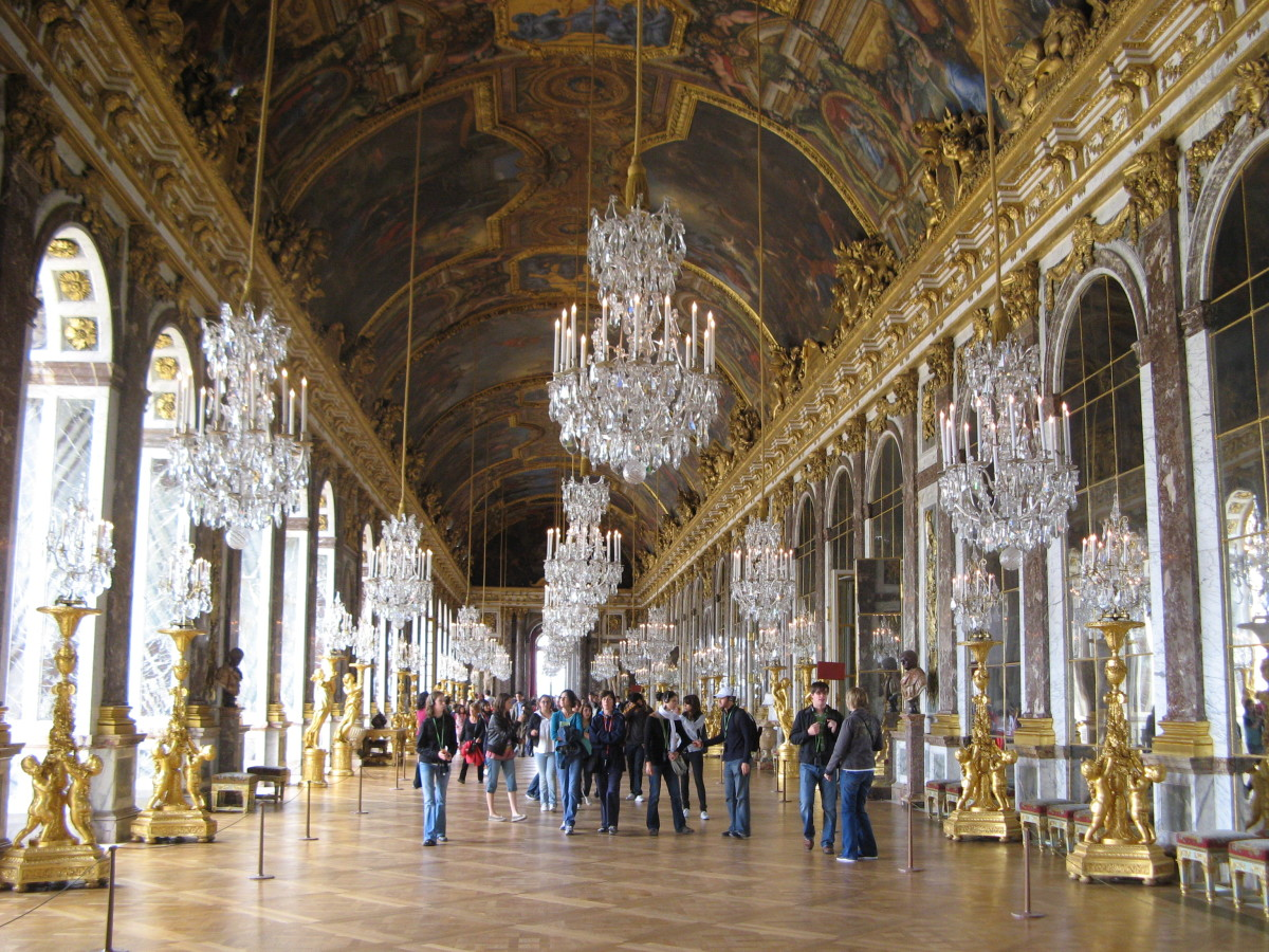 HALL OF MIRRORS IN THE PALACE OF VERSAILLES DISPLAYS THE GRANDEUR OF THE SUN KING