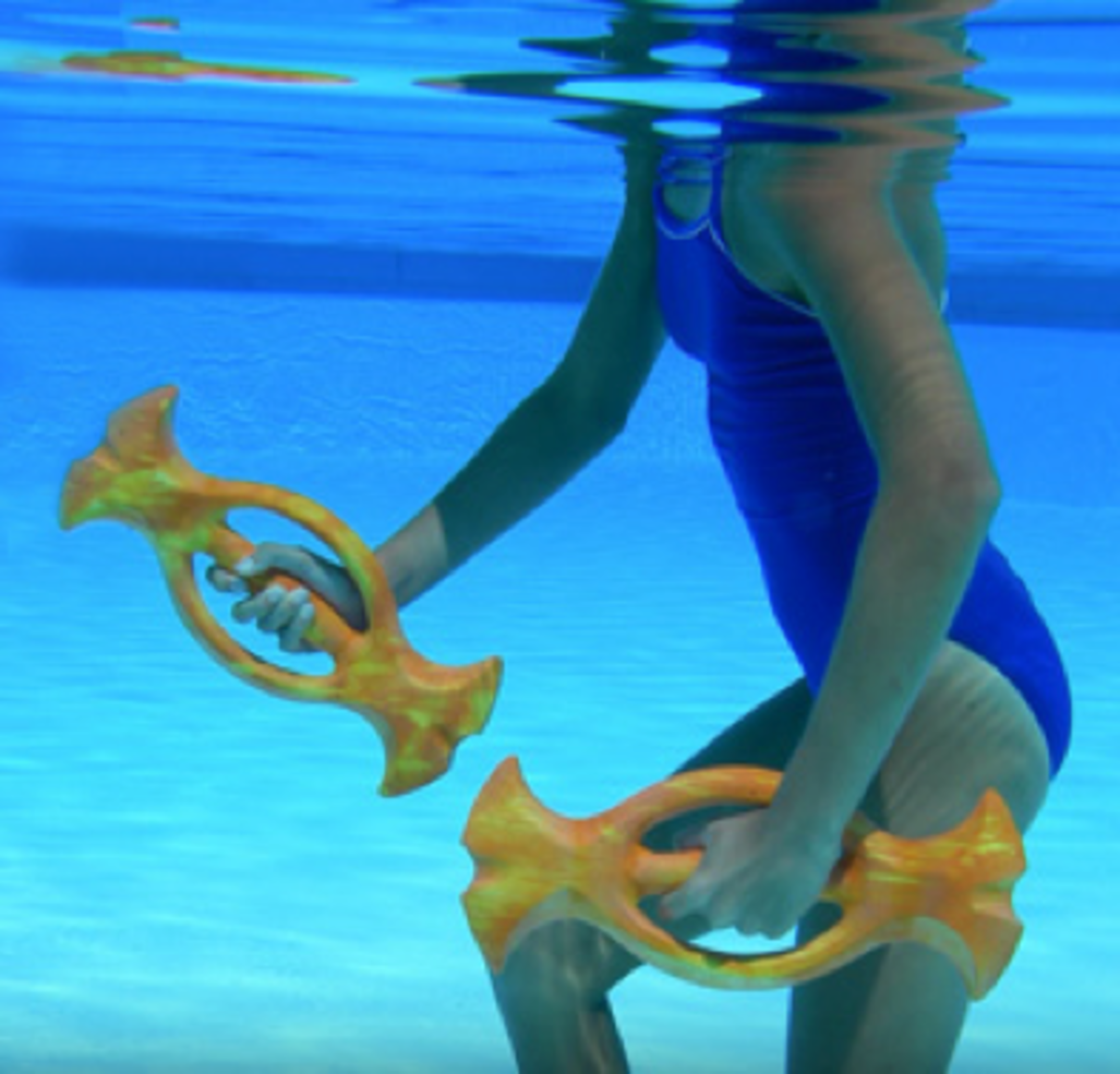 Ergo Bells in use - under water photo showing the aquatic barbell use in the water by a female in a blue one piece swim suit