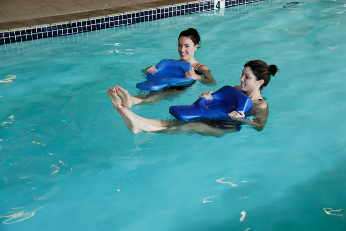 two young girls using the blue body board