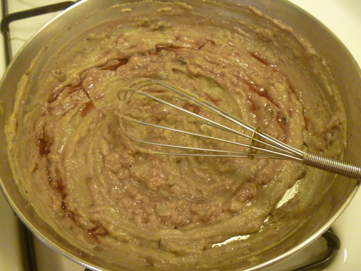 Step 4: Whisking in the wine a little at a time