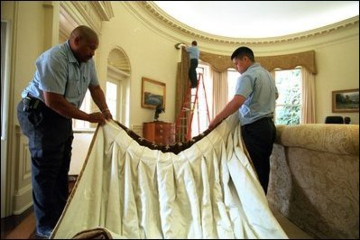 Workers bring in the new drapes for the Oval Office. Photo taken December 20, 2001.