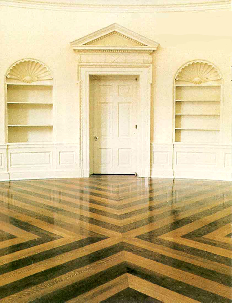The Oval Office flooring was replaced during the Bush Administration. The floor, made of walnut and oak with its contrasting pattern was from a design by Eric Gugler, a White House architect during the FD Roosevelt years.