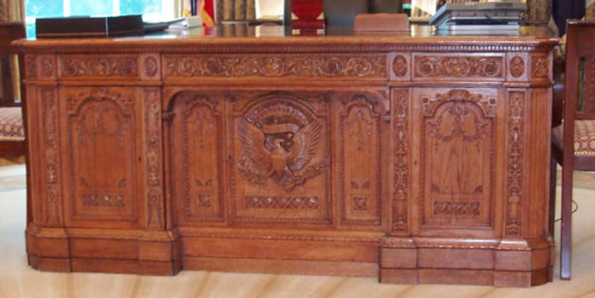 The panel face of the Resolute Desk, given to the United States by Queen Victoria. Presidents have used it off and on since then. President Clinton brought it back into the Oval Office and has been used by the presidents since then.