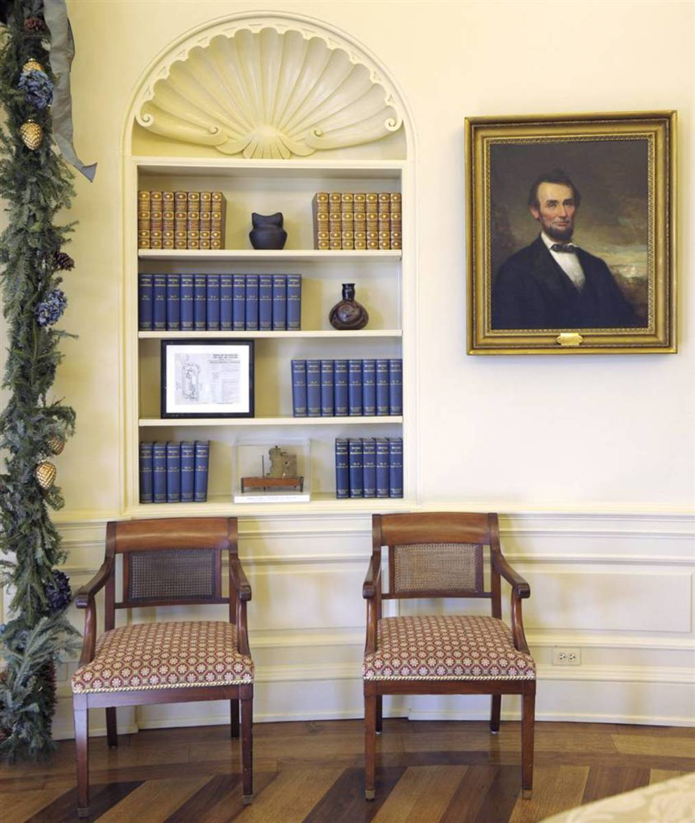 The likeness of Abraham Lincoln graced the Bush Oval Office two times: first, this George Story painting of Abraham Lincoln (above) along with a bust of the 16th president by Augustus St. Gaudens (below).