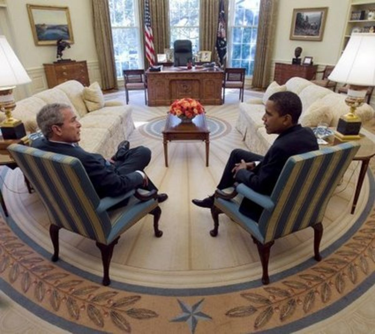 President Bush meets with President-elect Obama in the Oval Office. These blue and gold striped chairs were the center of many photographs that Bush had taken with Oval Office guests.