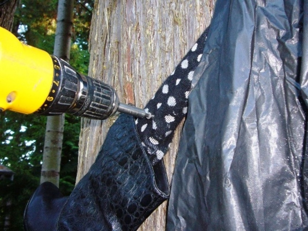 Use screws or nails to attach the legs to the tree under the cape.