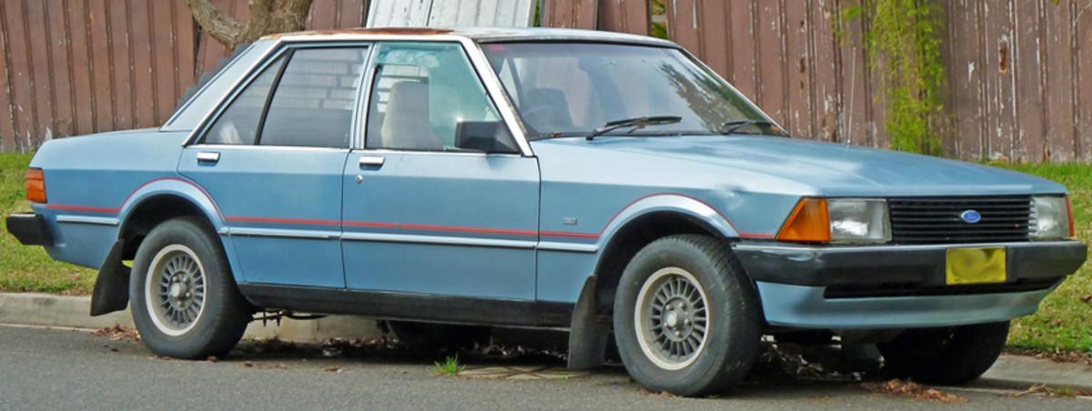 Ford Falcon XD sedan circa 1980. Street condition not all that good !