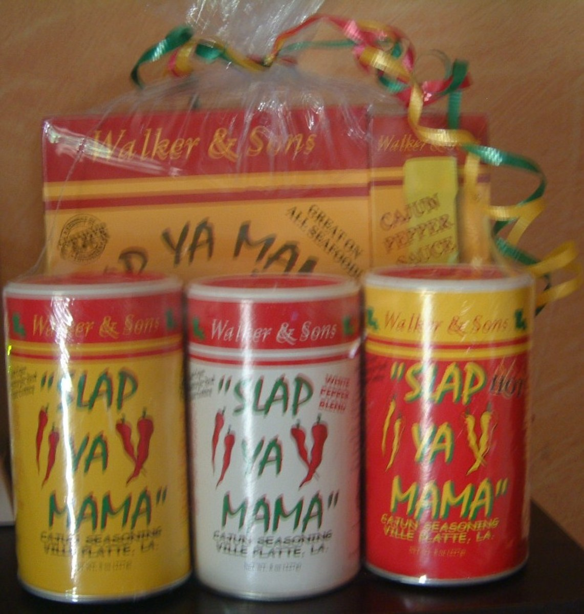 A gift pack of  Slap Ya Mama Cajun fish Fry, Cajun Pepper Sauce, Cajun Seasoning, White Pepper Blend and Hot