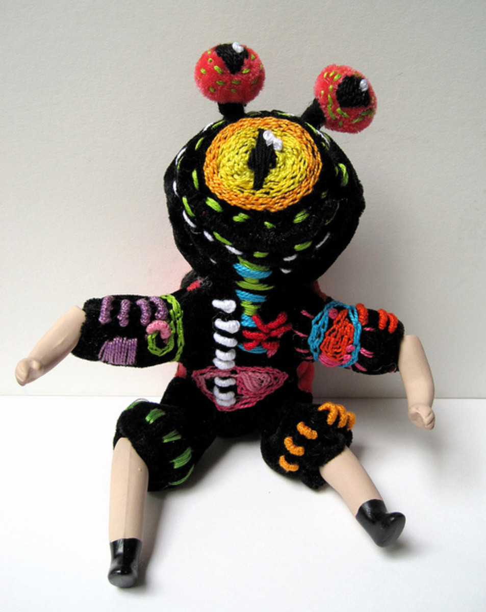Experiment with your embroidery! This particular example is made up from an old china doll and a stuffed toy, with embroidery then added over the top - I love it!