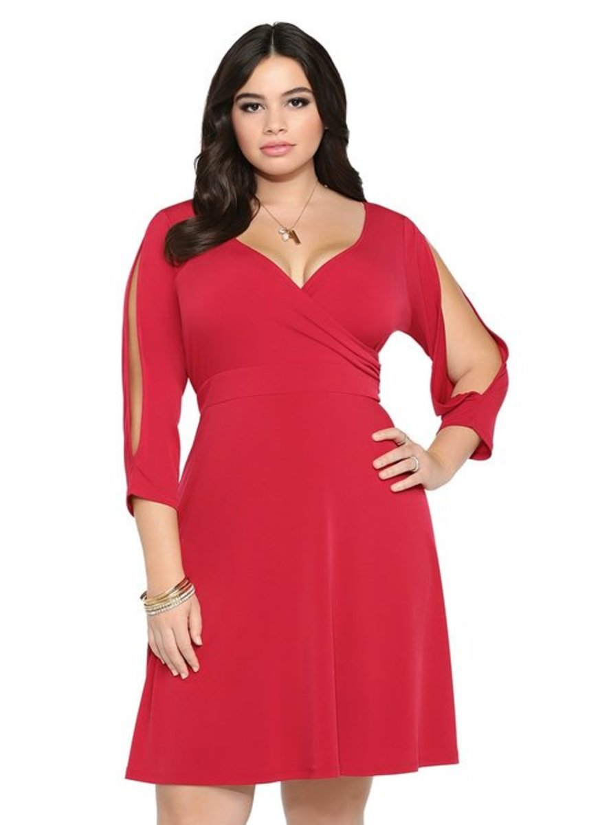 Plus Size Cold Shoulder Dress.  Who can resist that neckline enhancing your bust?
