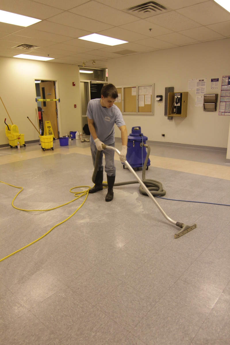 vacuuming dirty solution from the floor