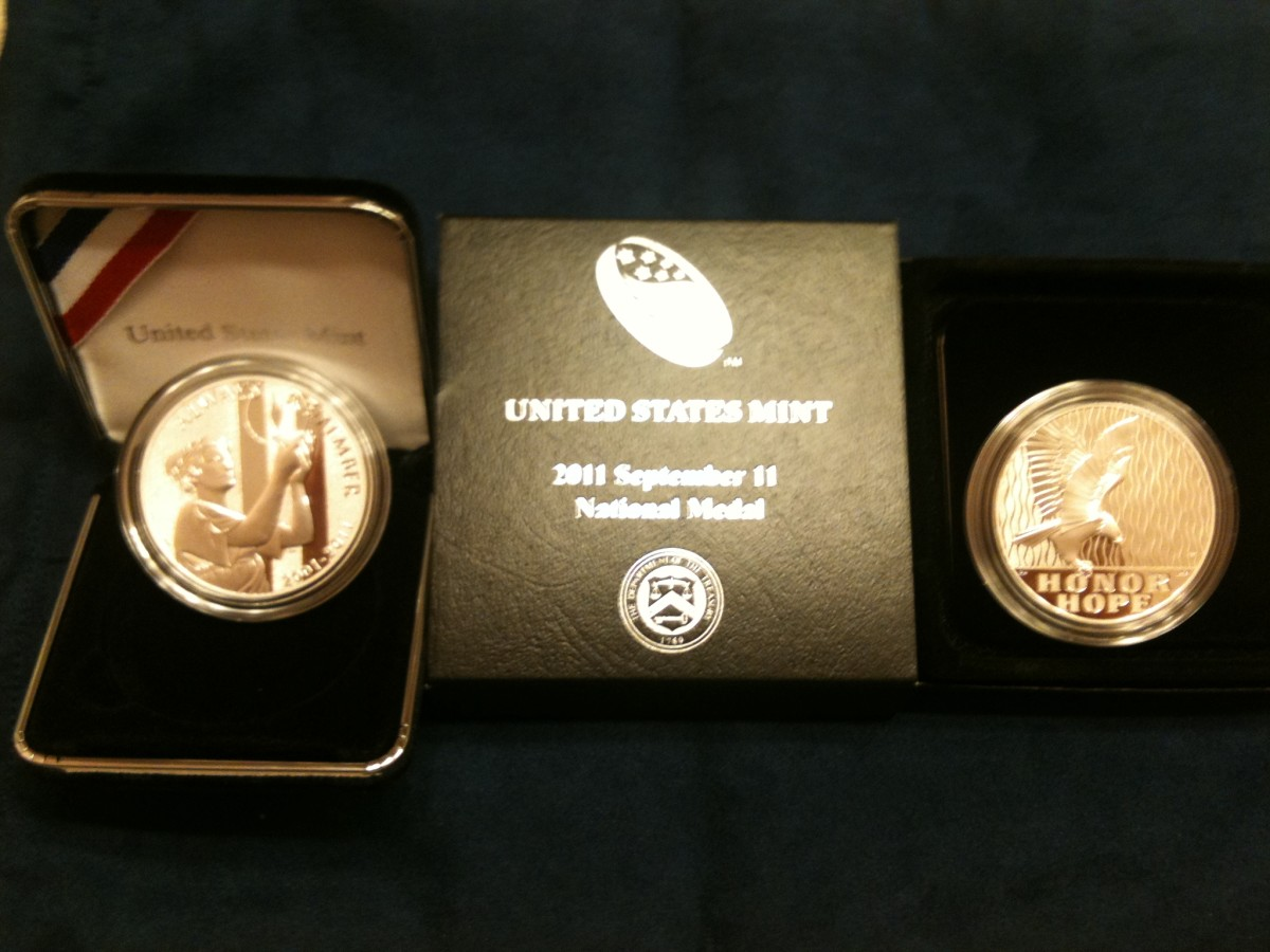 FRONT AND BACK OF THE NEW 10th ANNIVERSARY MEMORIAL MINTAGE FOR THE 9-11 TERRORIST ATTACK ON AMERICA.