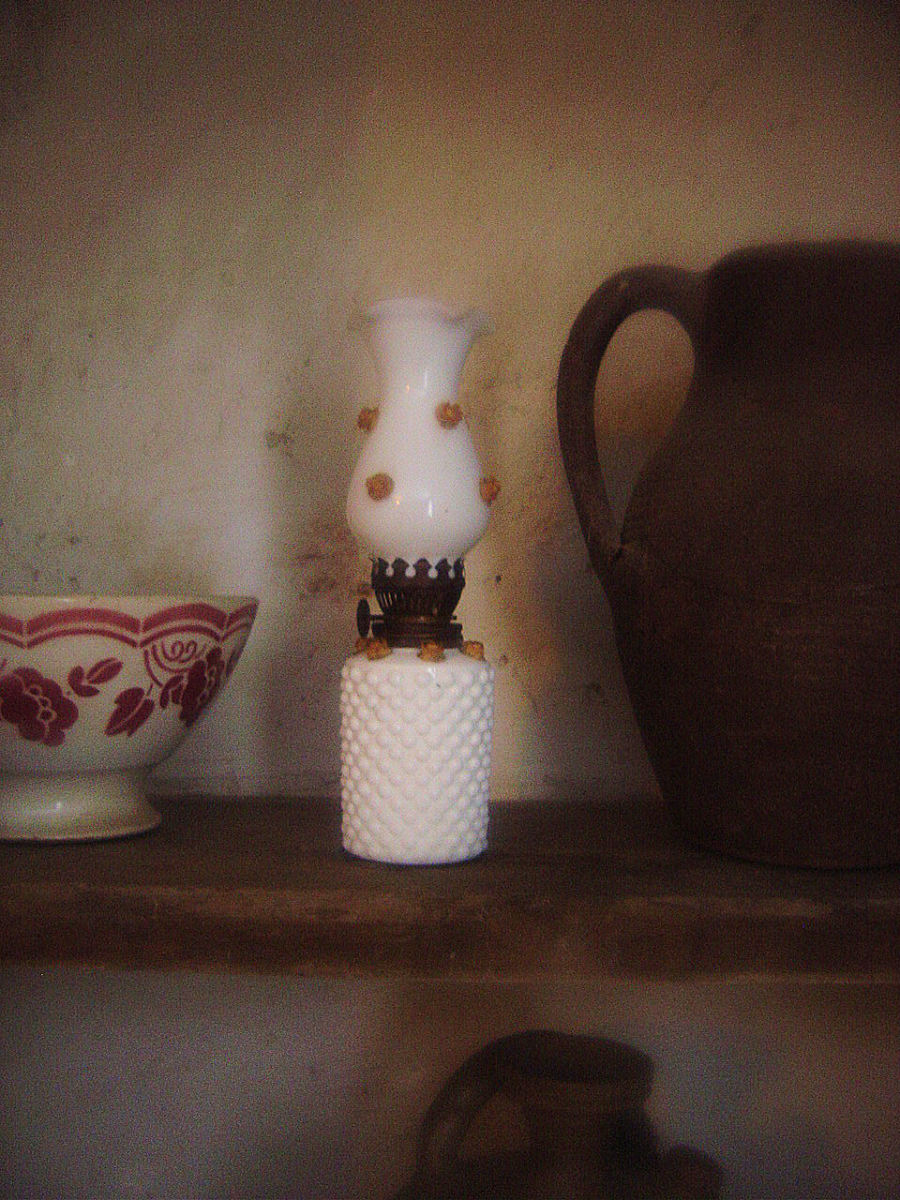 Madame Bess's oil lamp - don't hink it's Limoges porcealin though