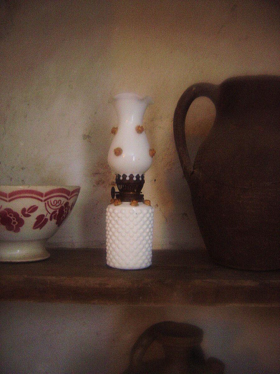 Madame Bess's oil lamp - don't hink it's Limoges porcealin though