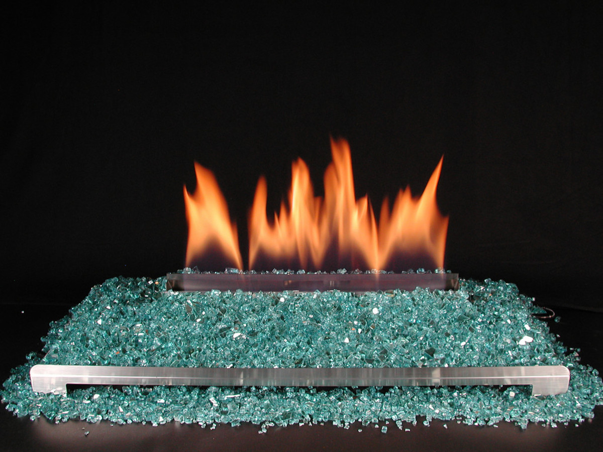 aqua fire glass on a stainless steel ventless gas fireplace burner.
