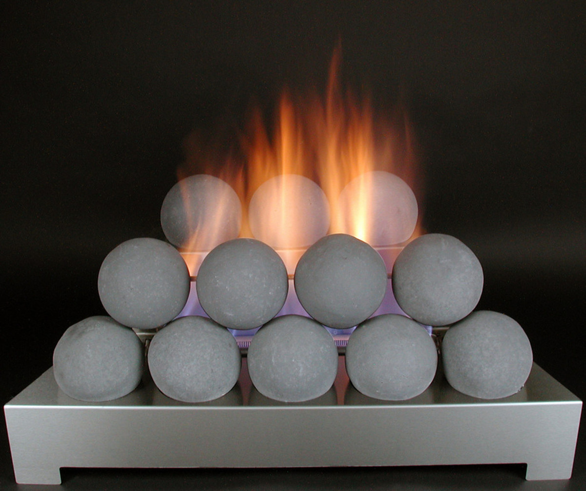 ventless gas fireplace fire balls stacked like olde cannon balls with fireplace flames from a stainless steel unvented gas burner.