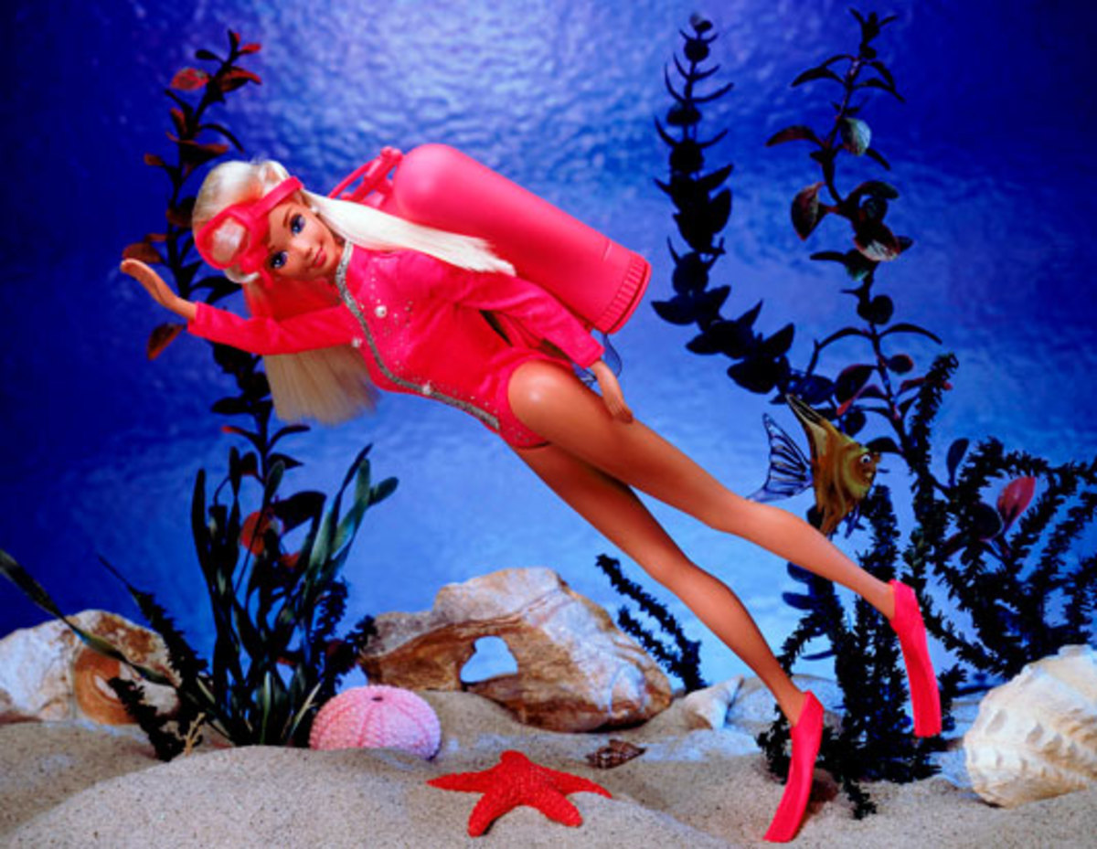 Barbie dress in red scuba gear including red fins and scuba tank