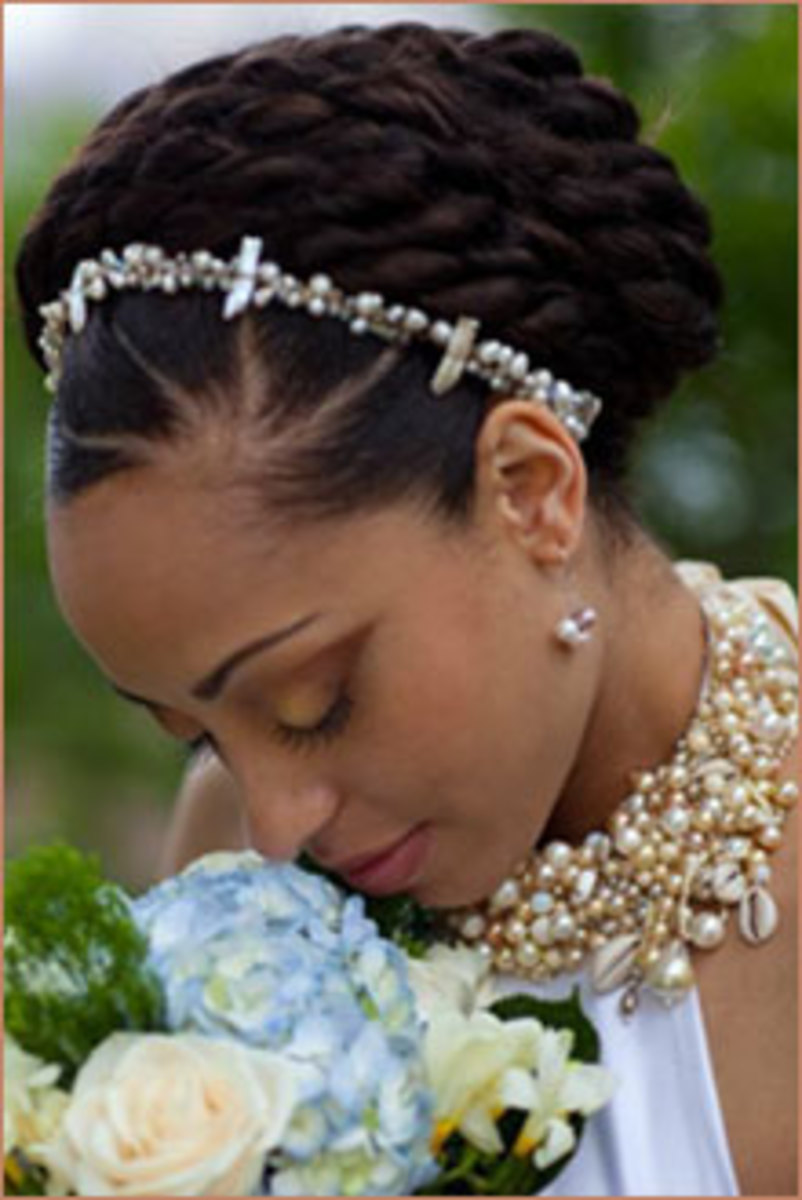 A braided bun creates a  soft and demure style.