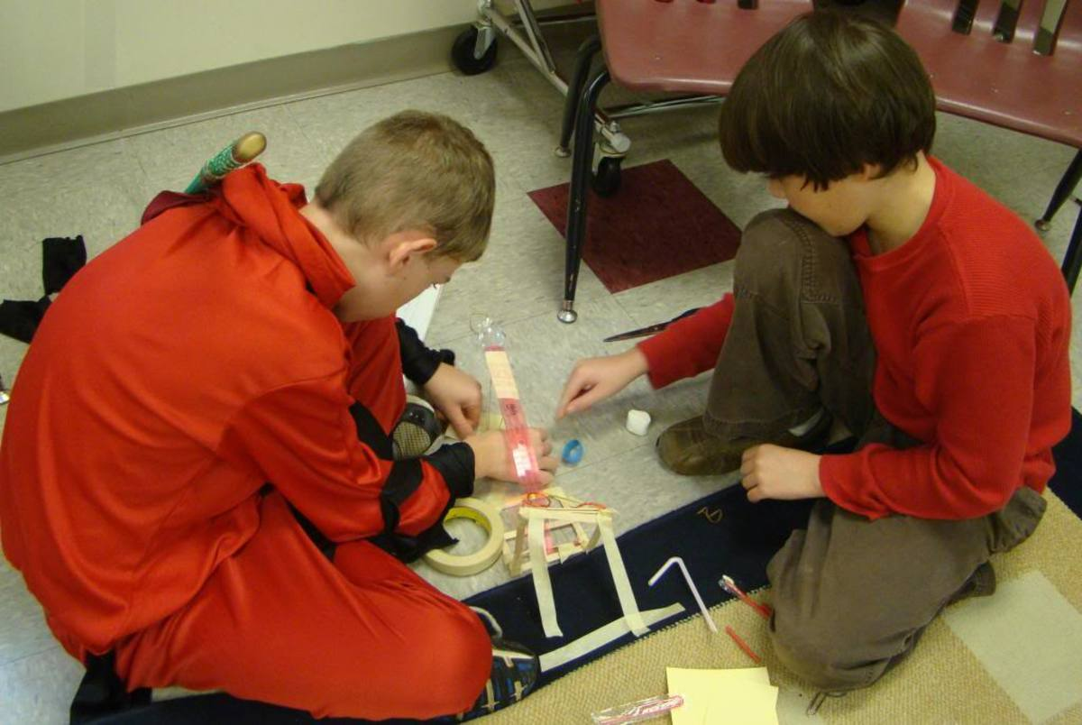 Making a catapult, without directions, during a critical thinking class.