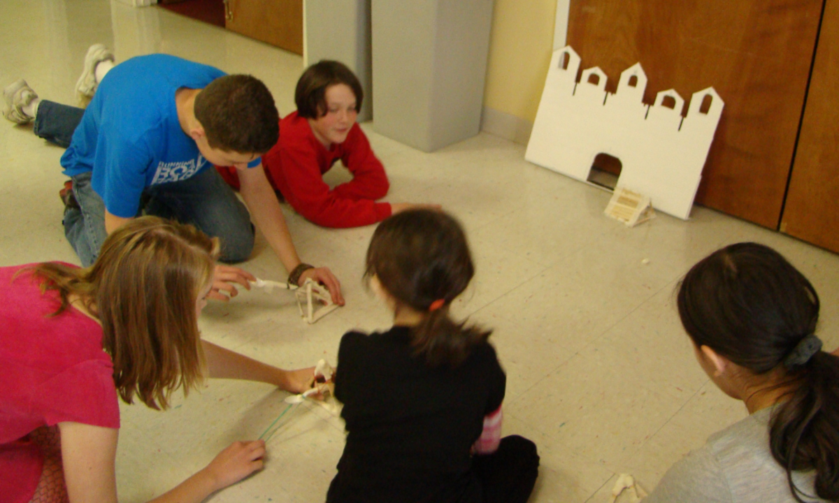 Using homemade catapults to launch miniature marshmallows at the castle!