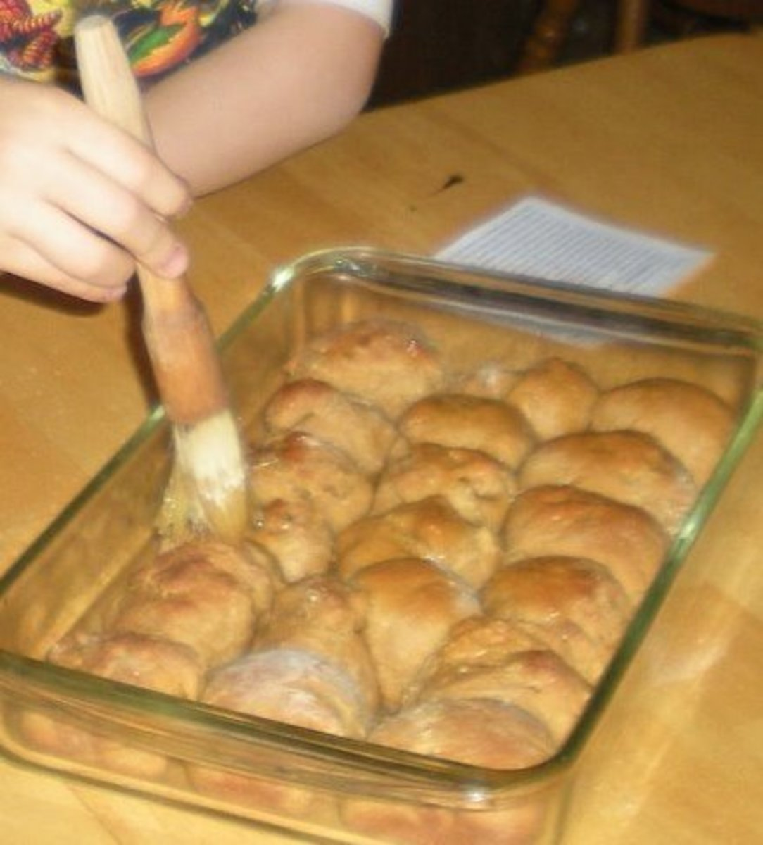 Buttering the cornmeal molasses rolls