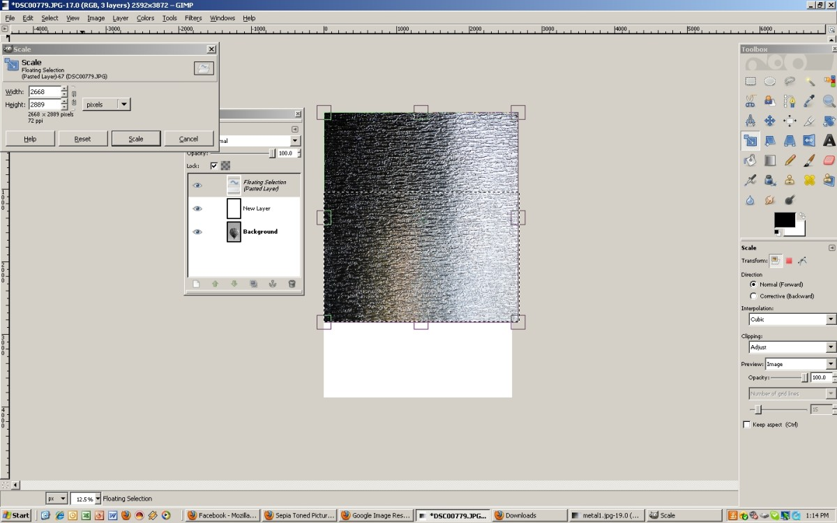 Resize the metallic background as needed, prior to anchoring the new layer.