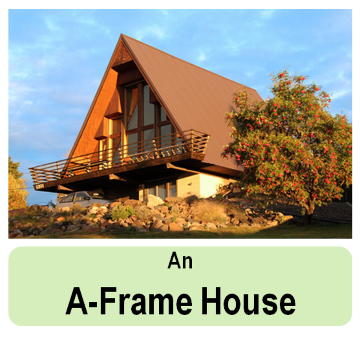 An A-frame house on a hill with a cantilever balcony and a car park below it. Set in an idyllic scenery, this timber home design is great for a secluded area.