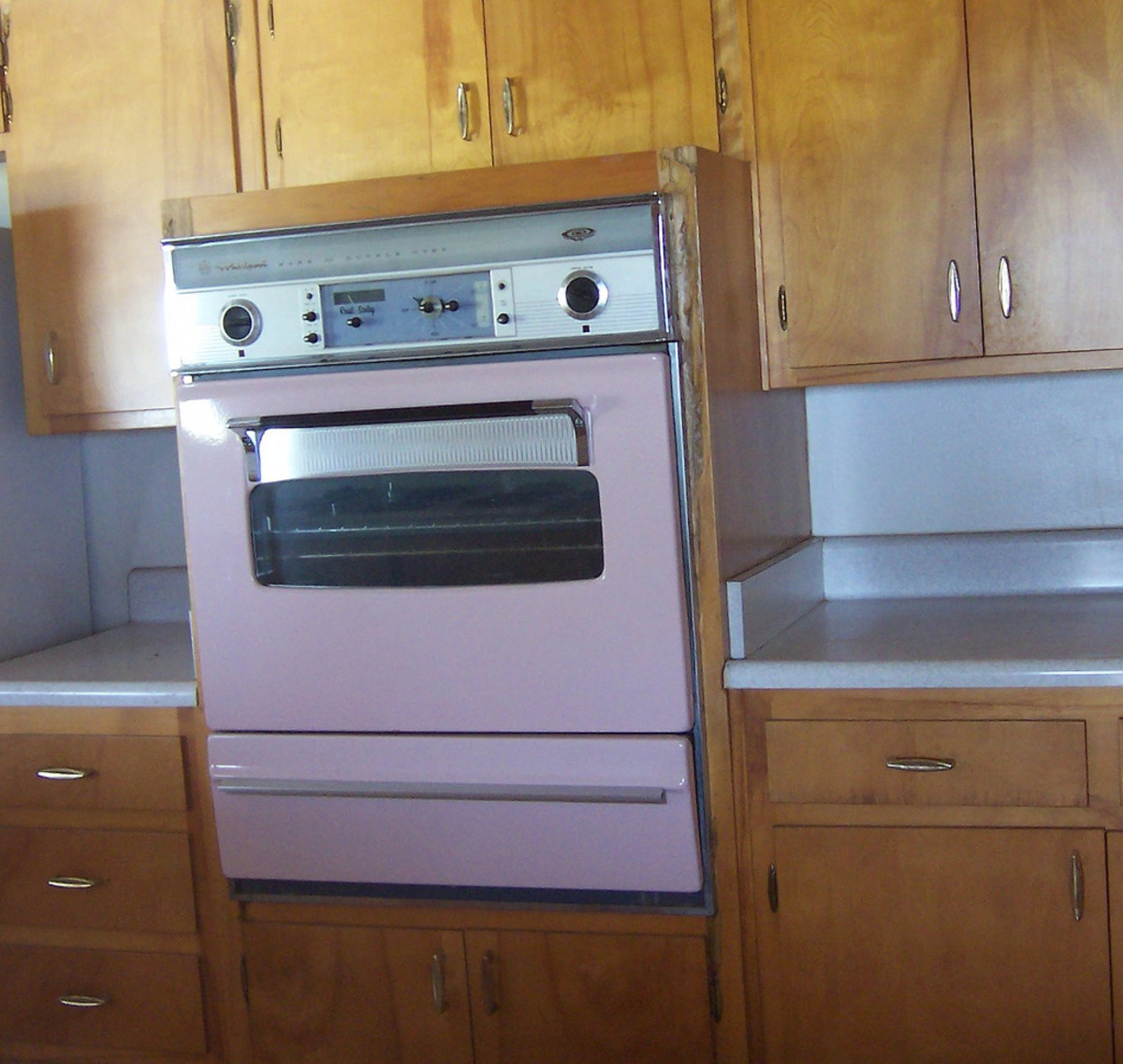 A pink wall oven is perfect for any retro girl's 50s kitchen.