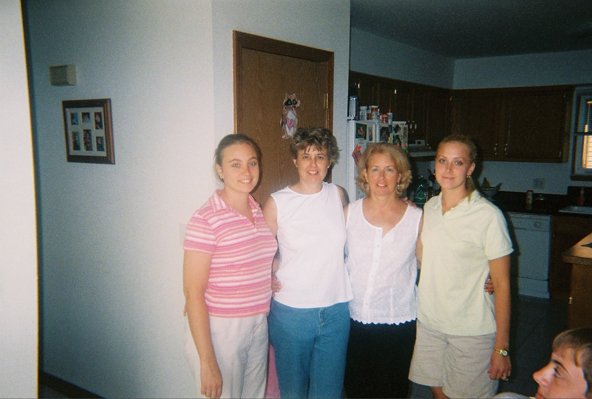 Danette and I in the middle between sisters: Cara and Christa