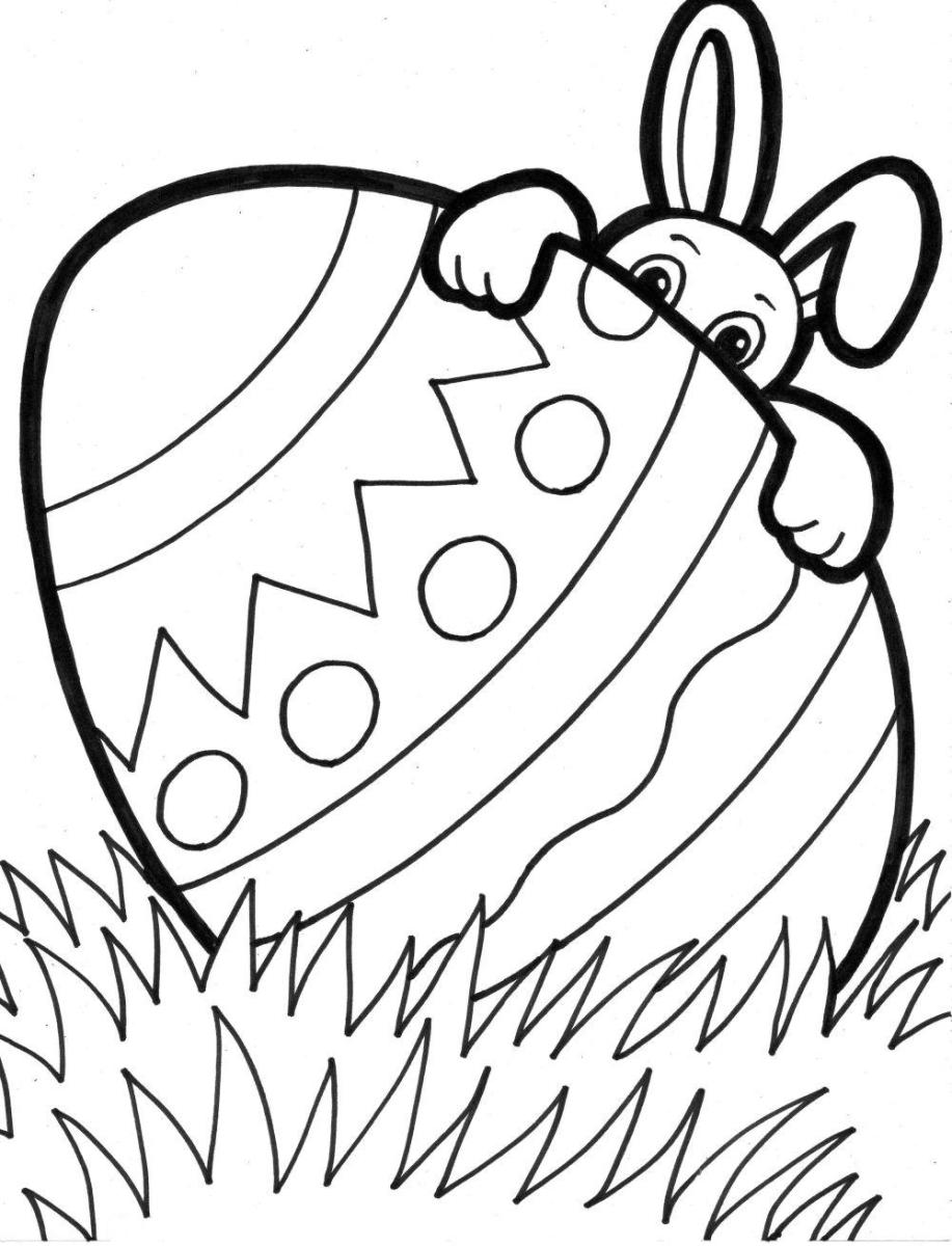 free coloring pages with religious themes | Bunny hiding behind Easter egg