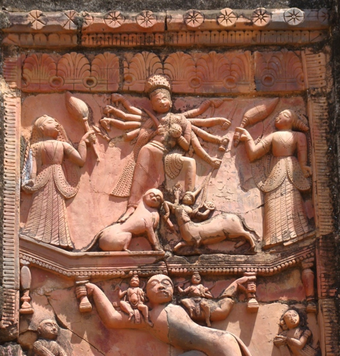 A scene from the epic Ramayana where Hanuman, the monkey Lord is carrying Lord Rama & Lakshmana on his shoulder & at the same time carrying Goddess Durga with his hands.