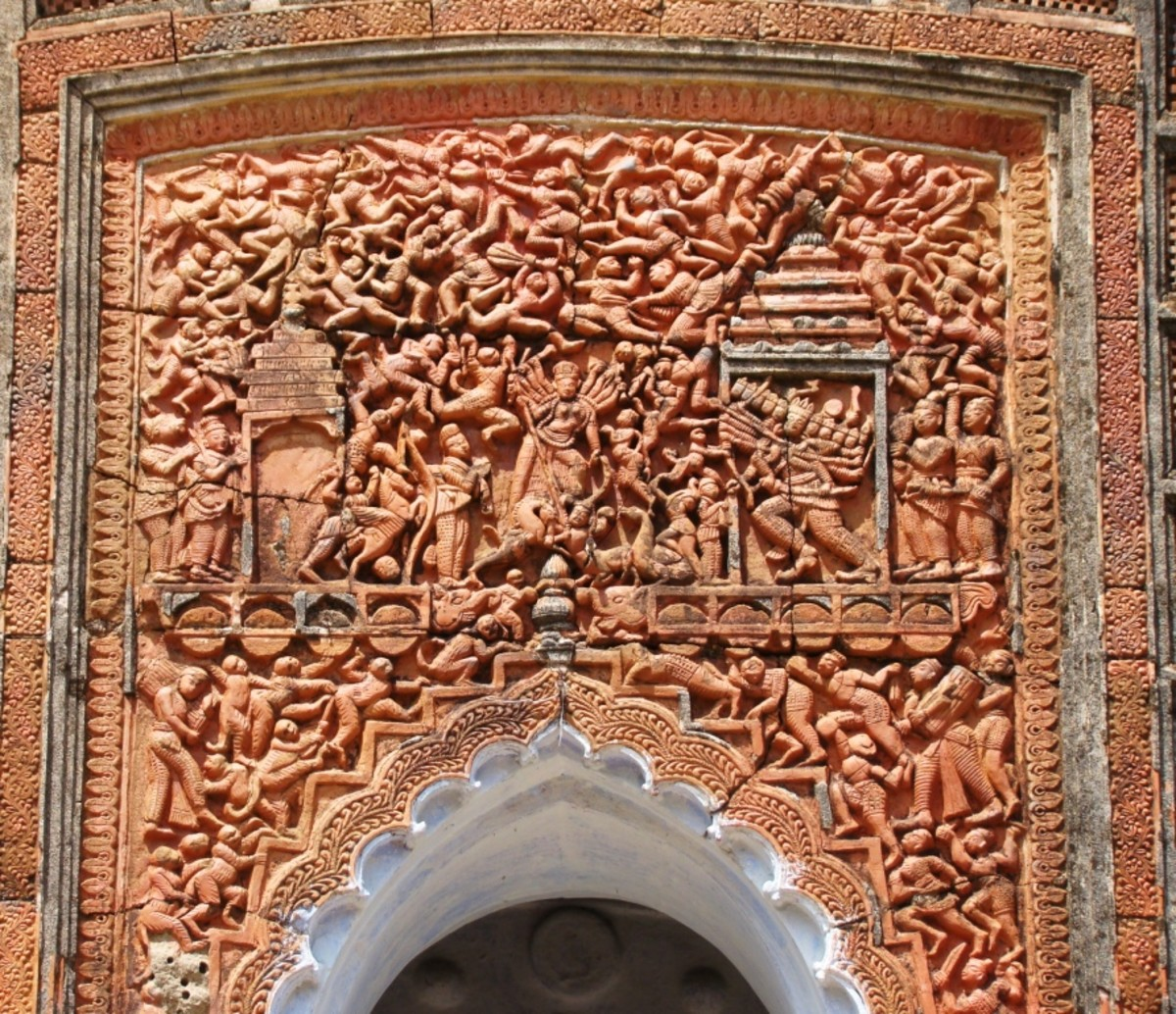 Rich terracotta art on the front facade of Navaratna temple of Mejo Taraf