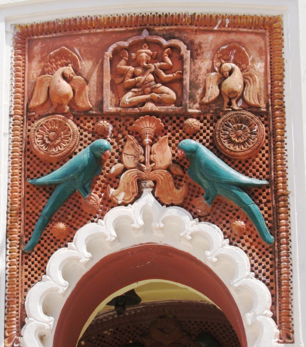 Terracotta panel. The green color on the parrots is a later addition.