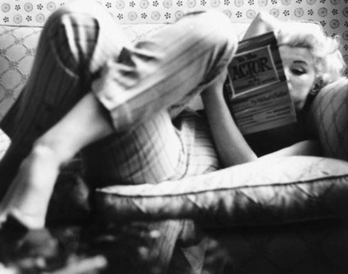 Marilyn Monroe at the Ambassador Hotel reading a book about acting, 1955.