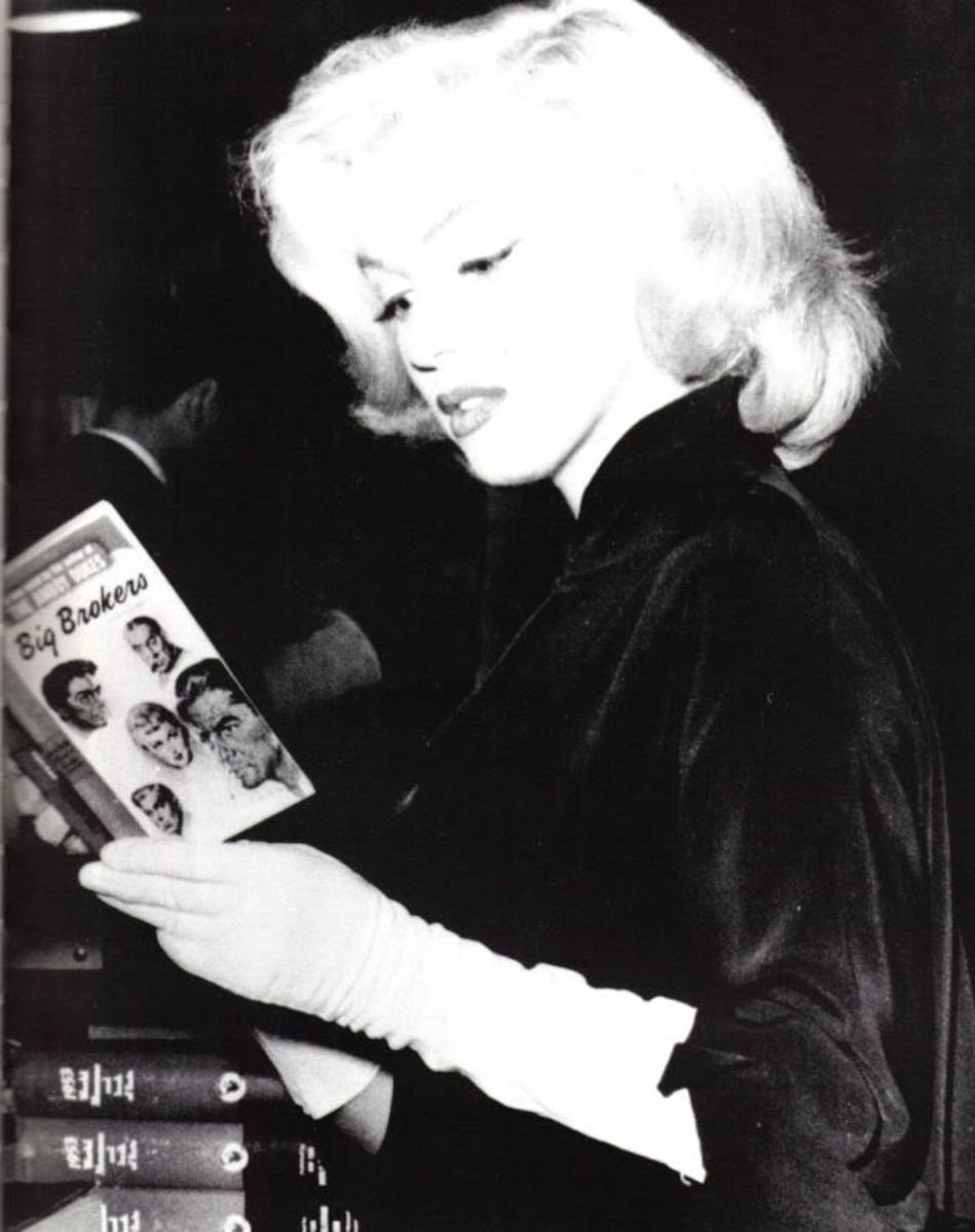 "Marilyn reading ""The Big Brokers"" by Irving Shulman"