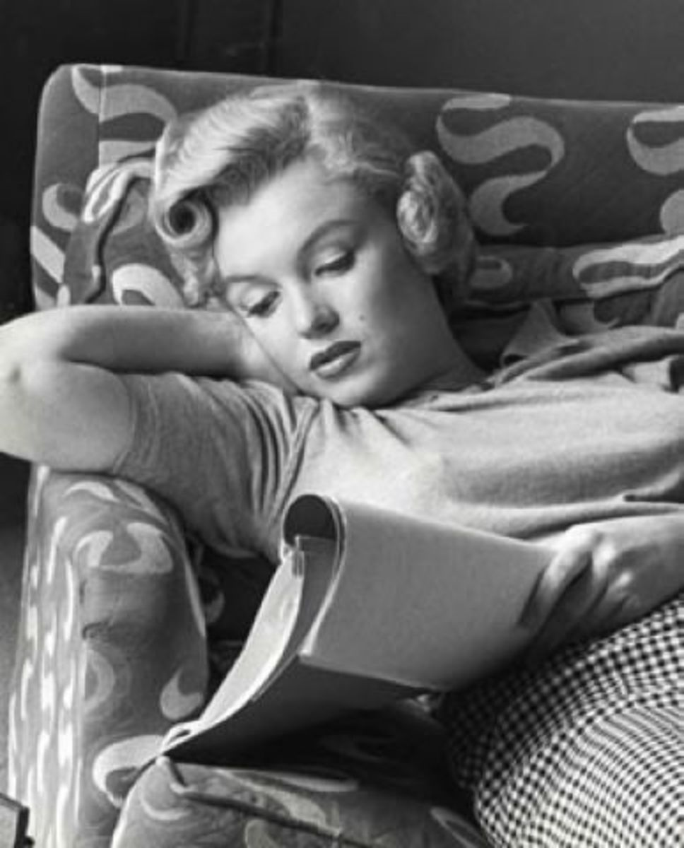 Marilyn Monroe relaxed reading a script.