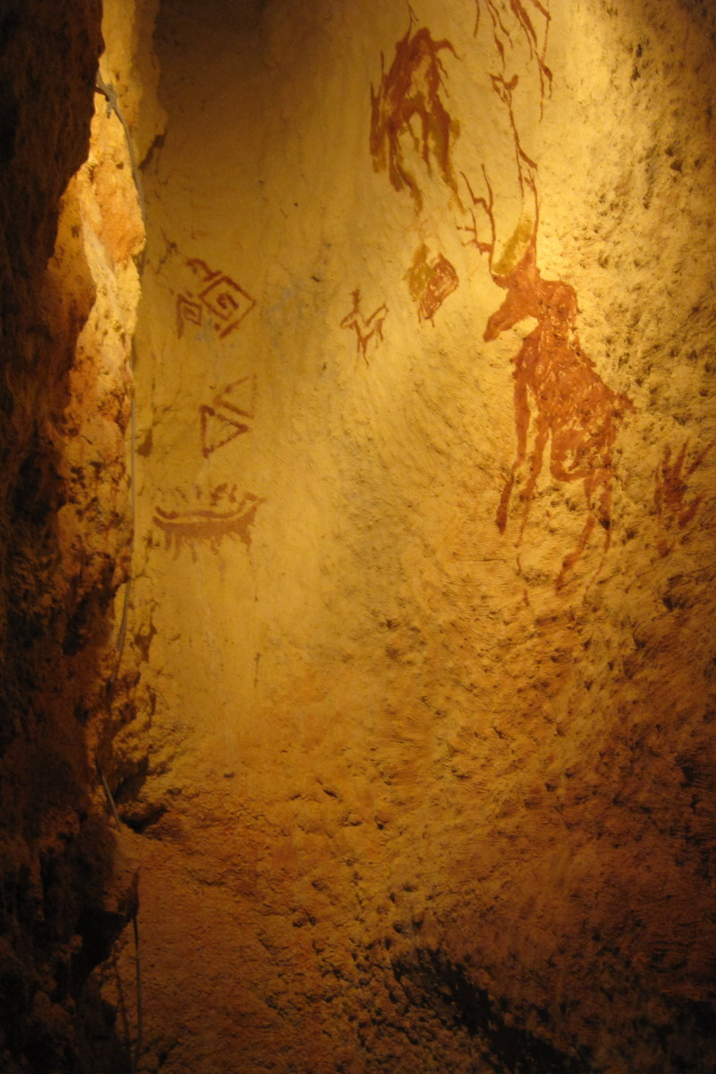 Cave paintings in outdoor cave area.