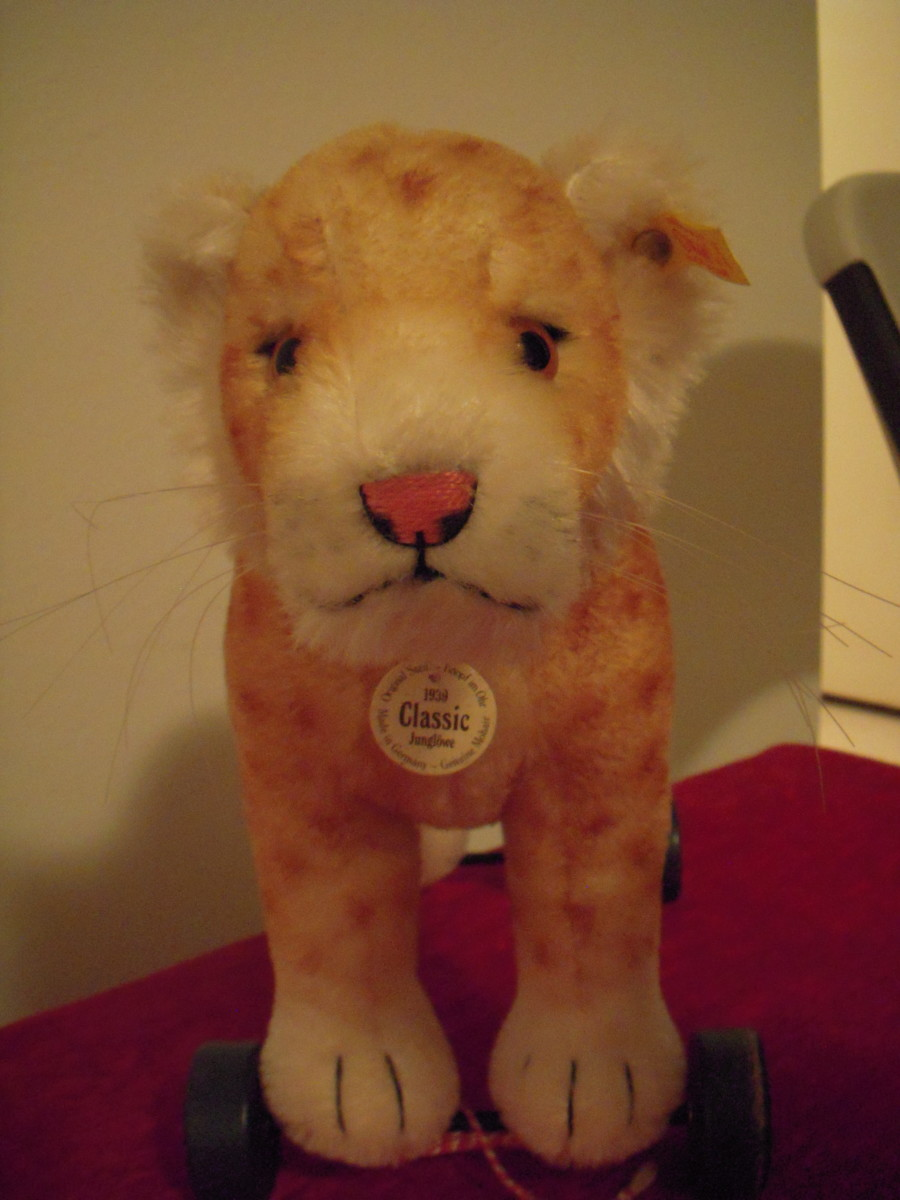 This cat-on-wheels Steiff has a white pendant and yellow ear tag. It's a replica of an older Steiff toy, but of unlimited run.