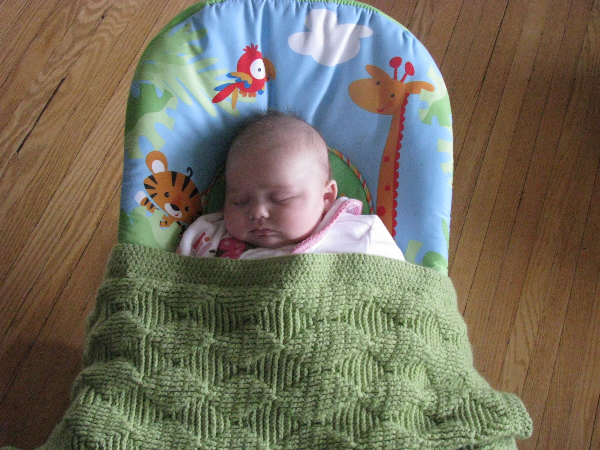 My daughter taking a little nap in the bouncer