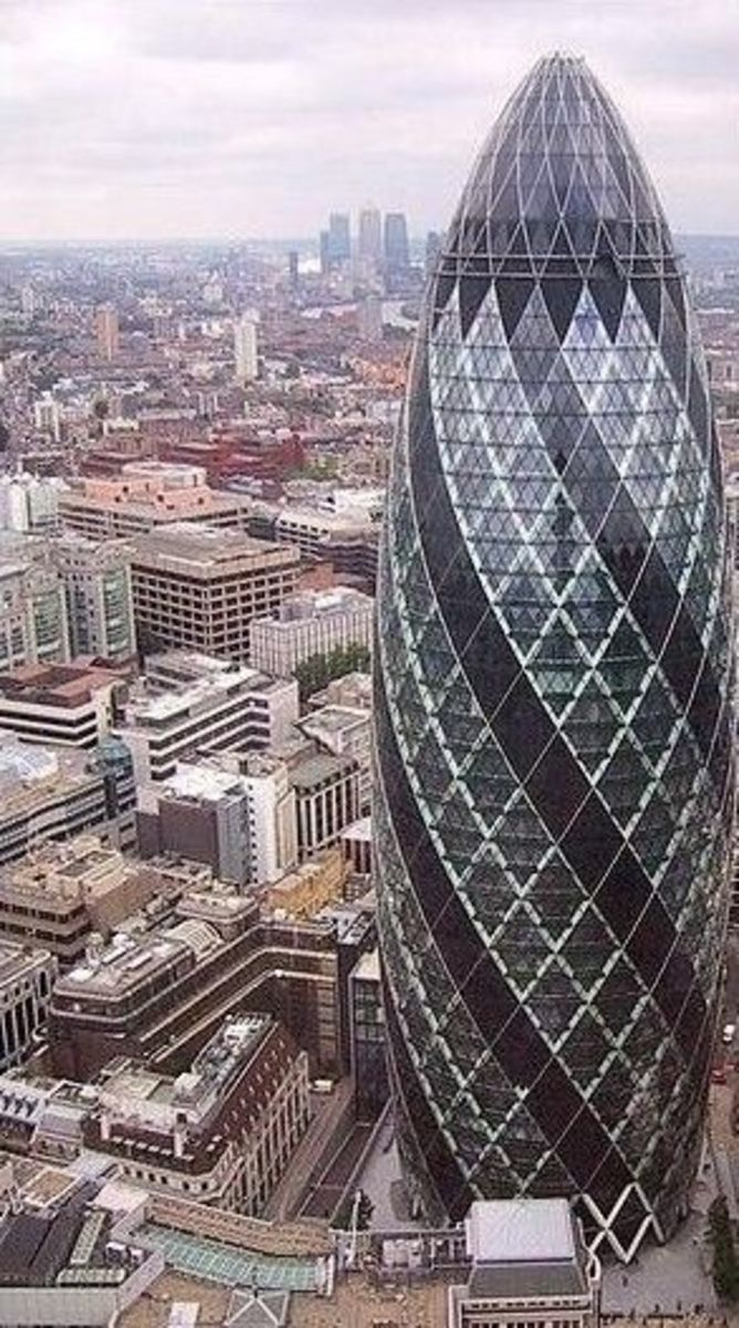 The the Swiss Reinsurance Head Quarter is know for it landmark shape and sustainable features making it and iconic building that grace the London sky-line. It 179.8 meters  tall with 40 number of floors and comprised of office, accommodation and  ret