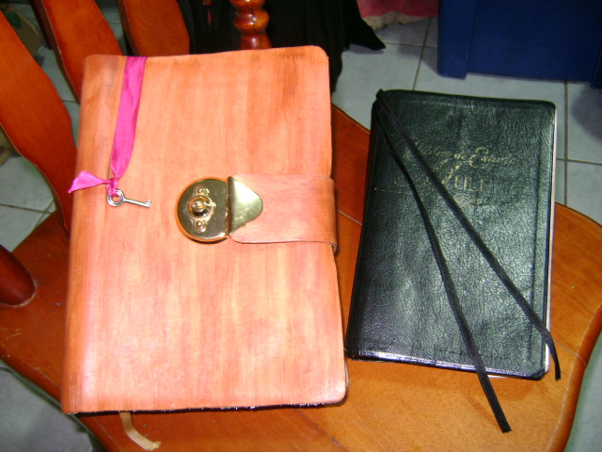 Two finished Bibles: The one on the Left is with a metal Lock and closing strap.  The one at Right is the Bible worked on in this tutorial