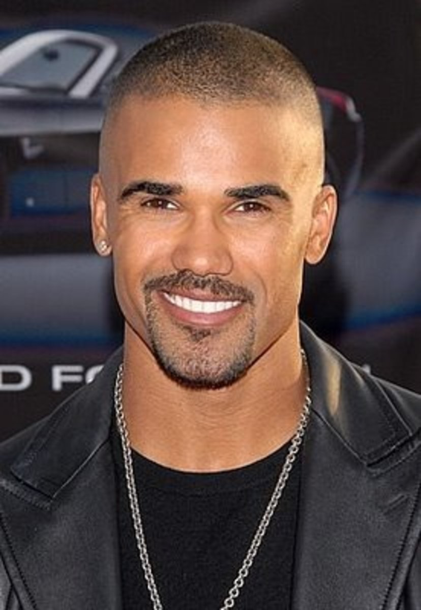 Shemar Moore, 43, aka Agent Morgan in Criminal Minds.  Shemar's hair is shaved on both sides and short short on top - 2013 Hairstyles for Men Short Medium Long Hair Styles Haircuts, by Rosie2010