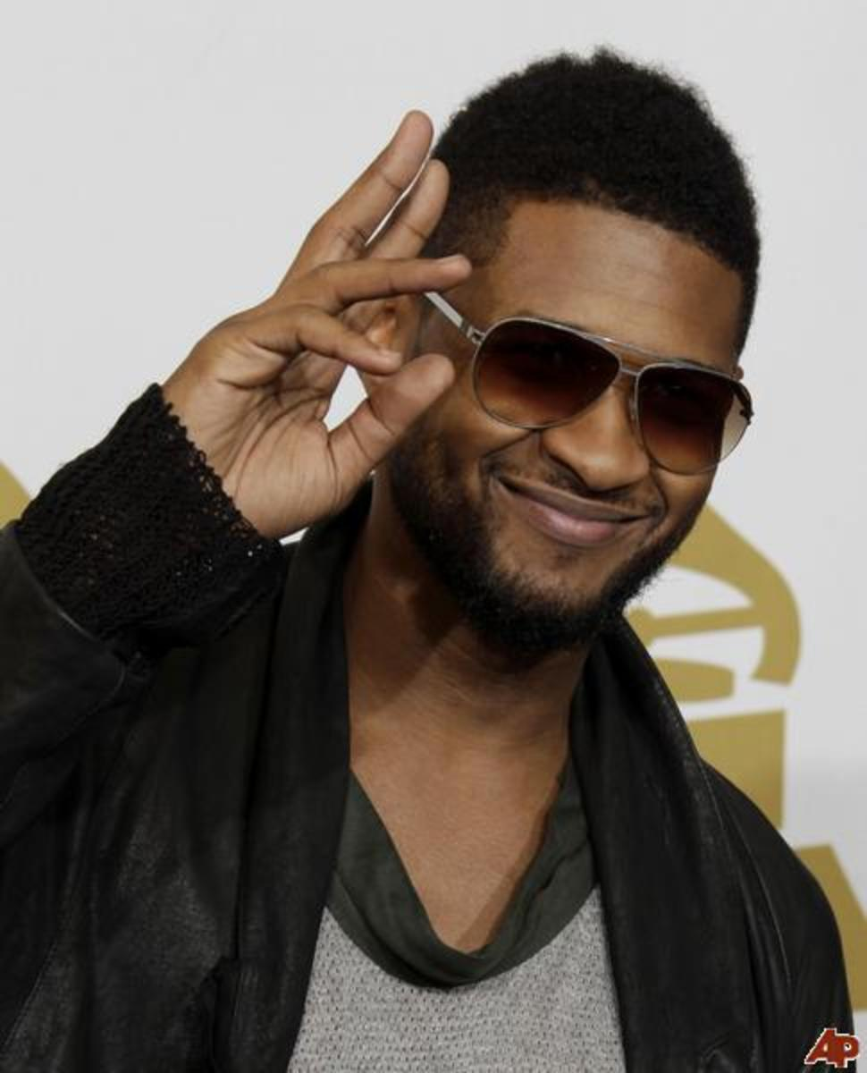 Usher, 34, at the Grammys.  Usher is wearing a medium square hair style for black men.  Usher's hair is cut short on both sides and long on top.  Very trendy. - 2013 Hairstyles for Men Short Medium Long Hair Styles Haircuts, by Rosie2010