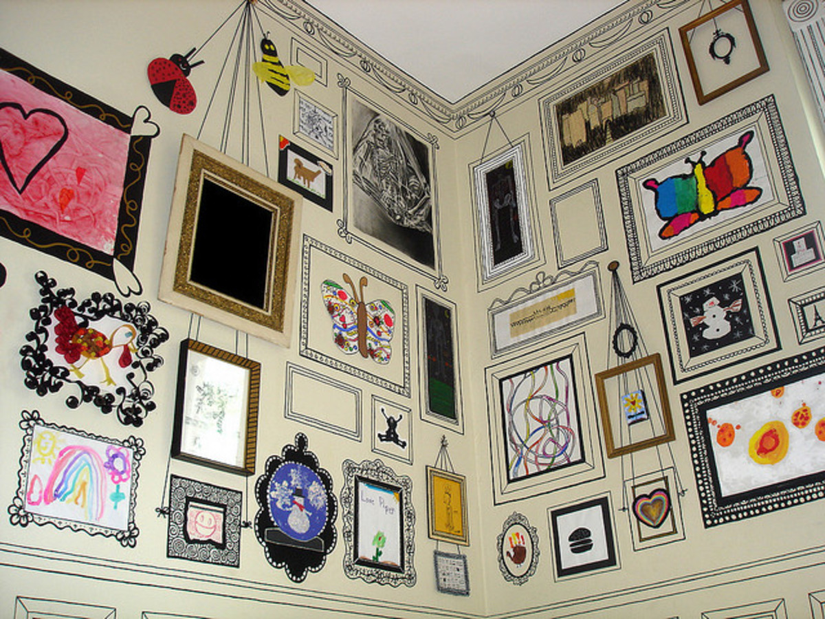 This fantastic craft room wall has been created by painting photo frames on plain wallpaper. Artwork and photos are stuck inside the frames.