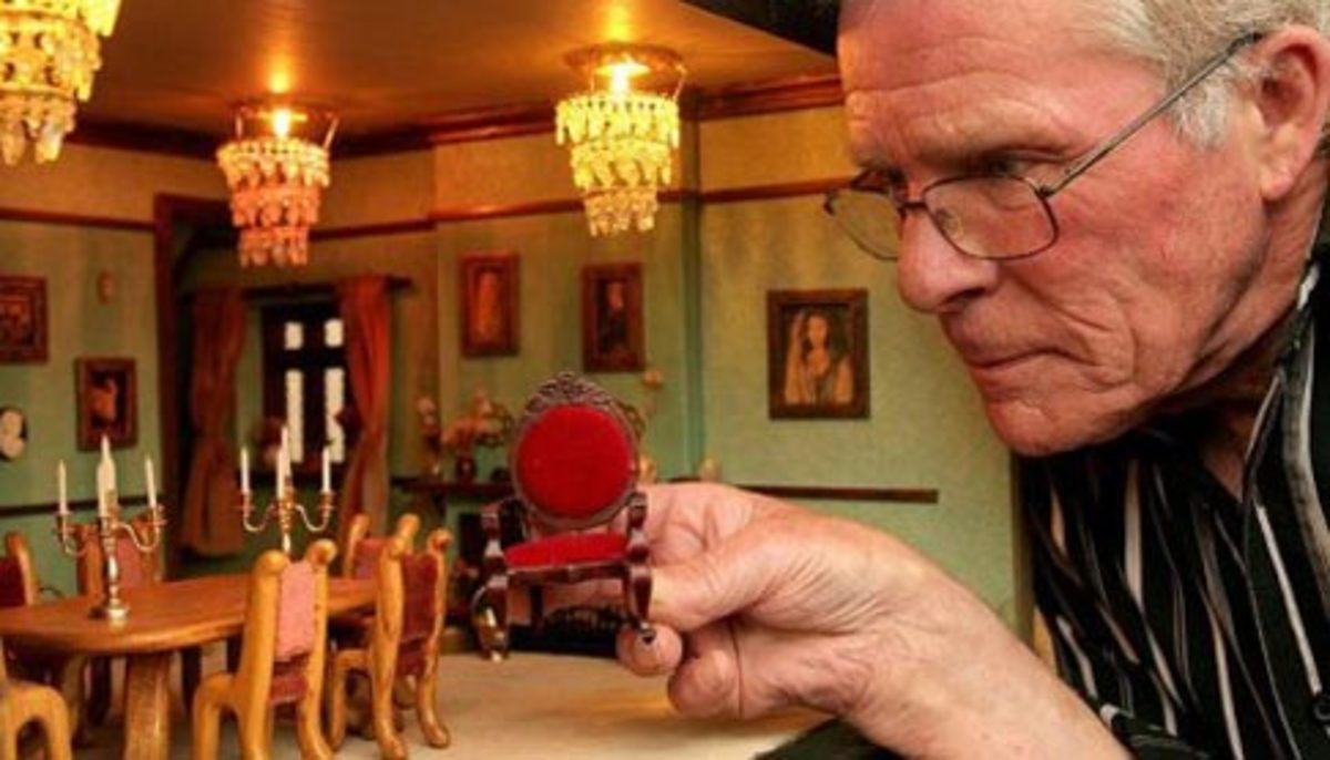 Peter Riches with his dollhous mansion. Photo from universeofluxury.com