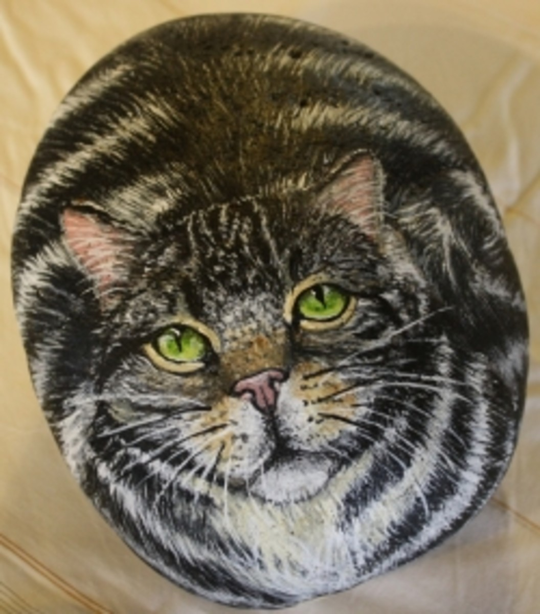 Tabby cat, acrylic on stone. Mary Hysong