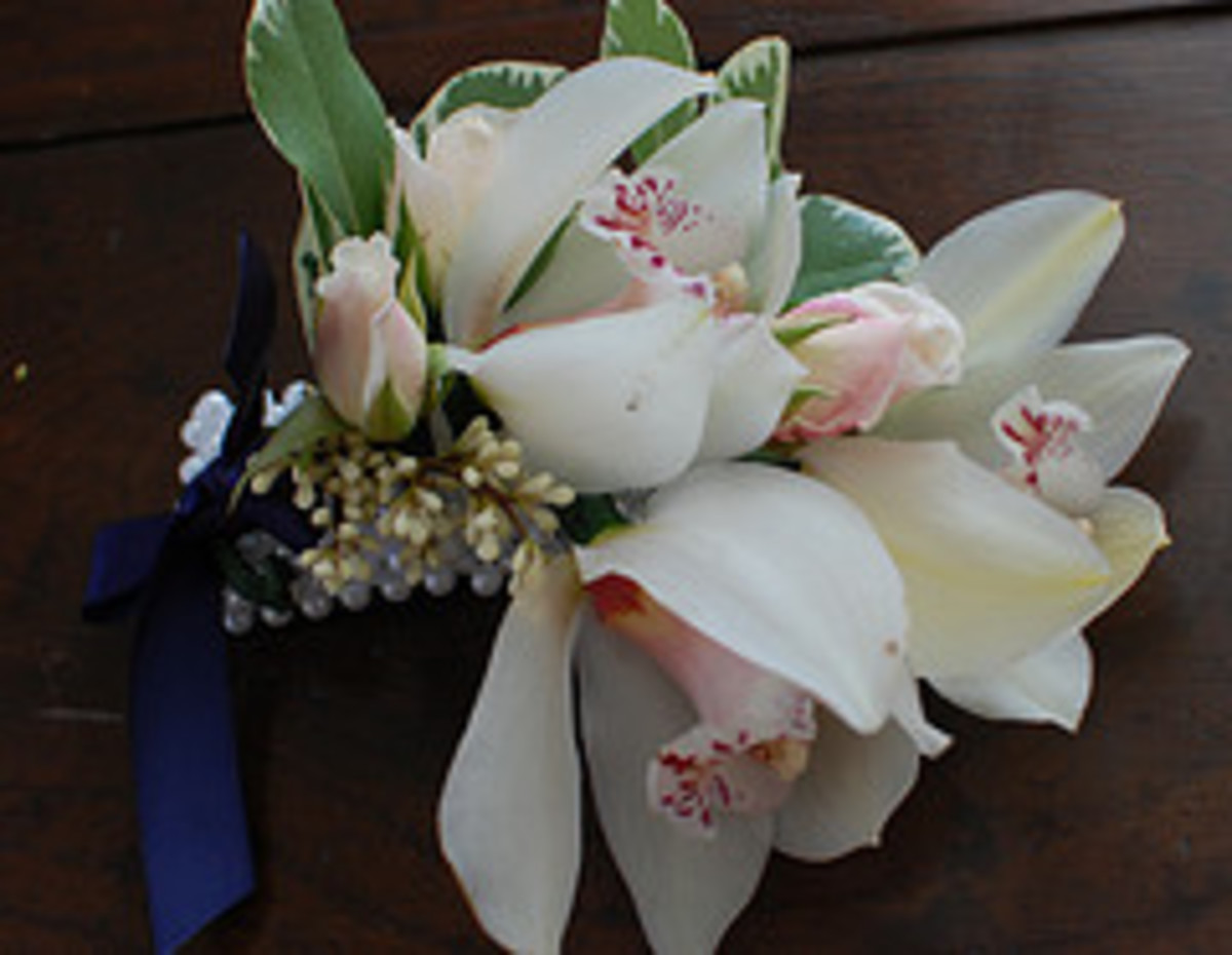 Matching corsage--three flowes and a couple of dainty roses.